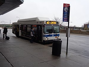 Woodhaven and Cross Bay Boulevards buses - A Woodside-bound Q53 bus in front of Queens Center, where the other three buses of the corridor terminate.