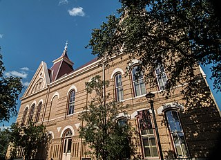 Old Main (Texas State University) red-roofed Victorian Gothic building on the campus of Texas State University–San Marcos