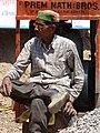 Man at Roadside - Bhagsu - Near McLeod Ganj - Himachal Pradesh - India (26718733872).jpg