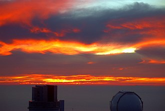 Observational astronomy - Sunset over Mauna Kea Observatories.