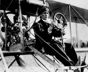 "Aerial Experiment Association - AEA member John Alexander Douglas McCurdy at the controls of the AEA Silver Dart during an aviation 'meet' near Toronto, Ontario, Canada, c. August 1911. The starboard-side ""shoulder-yoke"" structure for aileron control is visible beside the seated pilot."