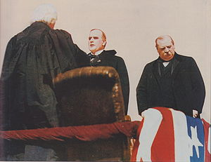 Presidency of William McKinley - Chief Justice Melville Fuller swears in William McKinley as president; outgoing President Grover Cleveland at right.
