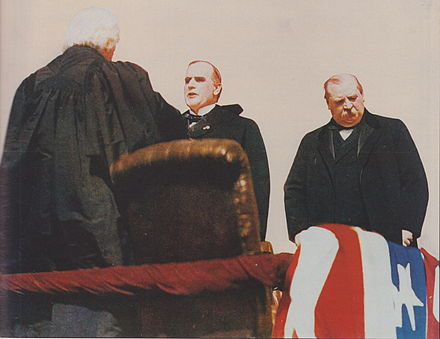 Chief Justice Melville Fuller swears in William McKinley as president; outgoing President Grover Cleveland at right. McKinley sworn in.jpeg