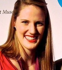 Head and shoulders photo of Missy Franklin, with shoulder-length hair and red blouse
