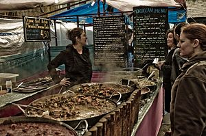 Customers looking to buy hot food from stall i...