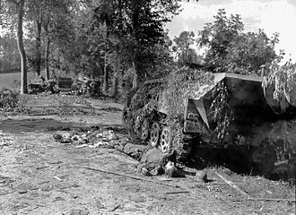 "2nd SS Panzer Division Das Reich - An armored SdKfz 251 half-track of the 2.SS-Panzer division ""Das Reich"" and the corpse of a German soldier near Mortain, 12 August 1944"