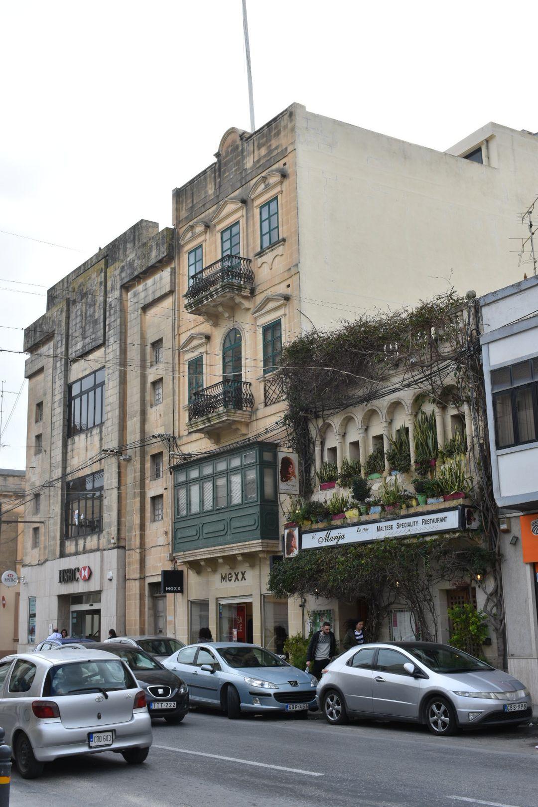 Abp 656 file:mosta former cinema, now bank, and maltese restaurant