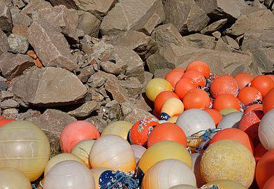 Multicolored fishing balls and granite.jpg