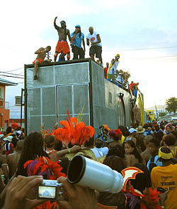 A Music Truck entertains the crowd on the streets. Trucks are an integral part of the street parade, featuring live performances or deejays