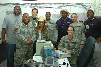 Bonnie-Jill Laflin - Laflin with professional football players during a visit to FOB Speicher in Tikrit, Iraq, in 2006