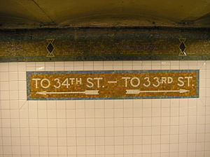 Mosaic sign on Penn Station subway station in ...