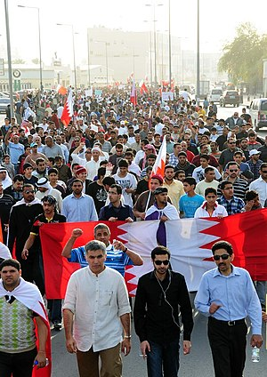 Abdulhadi al-Khawaja - Abdulhadi al-Khawaja (right), Ali Abdulemam (middle) and Nabeel Rajab (left) in a pro-democracy march on 23 February