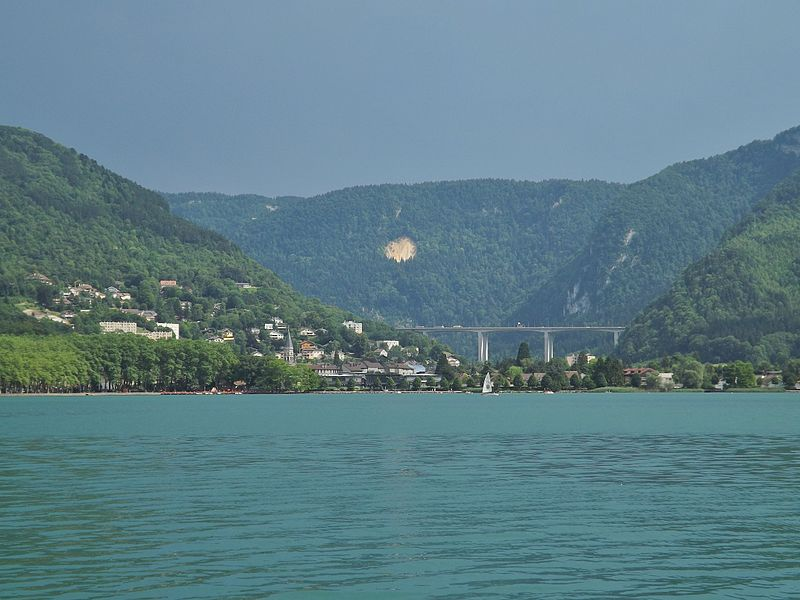 Panoramic sight of the lac de Nantua lake, the town of Nantua and the viaduc de Nantua viaduc, in the Jura mountains, in the French department of Ain.