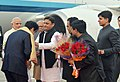 Narendra Modi and the Prime Minister of Japan, Mr. Shinzo Abe being received by the Governor of Uttar Pradesh, Shri Ram Naik and the Chief Minister of Uttar Pradesh, Shri Akhilesh Yadav, on their arrival at Varanasi (1).jpg