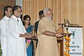 Narendra Modi lighting the lamp at the inauguration of the 86th Foundation Day of ICAR and ICAR award presentation ceremony, in New Delhi. The Union Minister for Agriculture.jpg