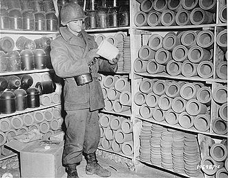 Natzweiler-Struthof - An American soldier in Natzweiler-Struthof examines an urn used to bury the ashes of cremated prisoners.