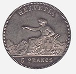 Helvetia seated, pointing left, holding Swiss shield. Legend above, denomination below.