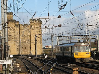 Newcastle railway station - A Northern Rail Class 142 leaving Newcastle in 2009, Castle Keep is in the background