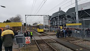Old Trafford tram stop - A M5000 breaks the stream of football fans at Old Trafford tram stop. Jan 2017.