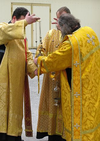 Incense - Orthodox Deacons preparing incense for a Cross Procession in Novosibirsk, Russia.