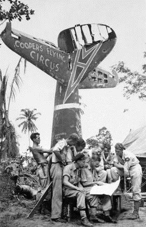 """No. 80 Squadron RAAF - """"Coopers Flying Circus"""": Squadron Leader Cooper (middle) with members of No. 80 Squadron in New Guinea, July 1944"""