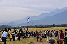 Spectators and a paraglider