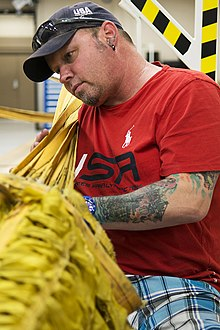 Patrick McDonald repacks a drag chute at Barksdale Air Force Base.jpg