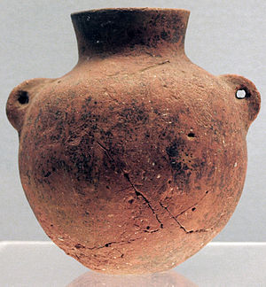 "Peiligang culture - Red pot with two small ""ear"" handles, from the Peiligang culture, c. 6000–5200 BC"