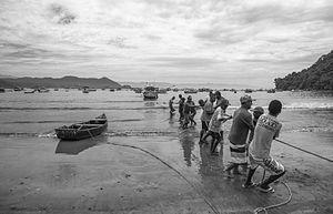 Caiçaras - Fishermen hauling in a boat in Guarujá, São Paulo state