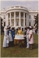 Photograph of First Lady Betty Ford Helping to Cut a Cake Marking the 75th Anniversary of the Visiting Nurses... - NARA - 186796.tif