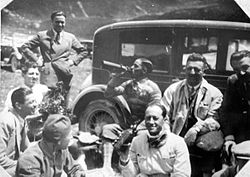 Nuvolari (fifth from left), with other Alfa Romeo drivers and Enzo Ferrari.