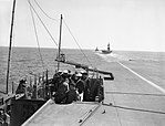 Pilots in the open bridge of the flight deck on board the aircraft carrier HMS ARGUS, in line astern with other ships of Force H in the Mediterranean, 1942. A7829.jpg