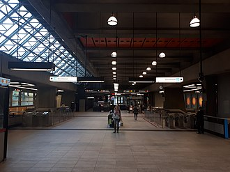Place-d'Armes station - The mezzanine at Place D'Armes métro station. Fare gates on both sides of the mezzanine.