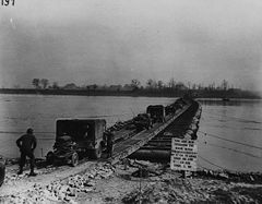 The U.S. 9th Army crosses the Rhine on a temporary steel treadway pontoon bridge, 1945.