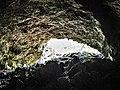 """Porche du """" fourneau de la Guémande """", vu du fond de la grotte.jpg"""