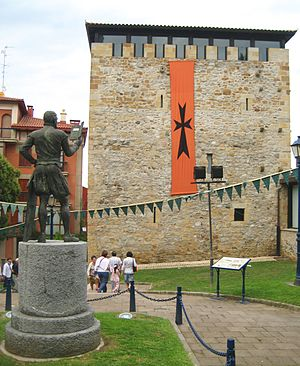 Biscay - Monument to Lope García de Salazar (1399-1476), opposite one of his tower houses, in Portugalete.