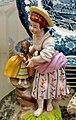 Porzellan Junge Frau mit verkleidetem Mops.jpg