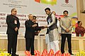 """Pranab Mukherjee presenting the Rajat Kamal Award for Best Editing of the film """"Tigress Blood"""" in Non Feature Films Section to the Editor, Shri Andi Campbell Waite, at the 62nd National Film Awards Function.jpg"""