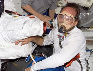 Space suit - Astronaut Steven G. MacLean pre-breathes prior to an EVA.