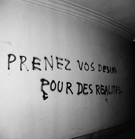 "A graffiti telling students to ""take your desires for reality"" in the Sorbonne, May 1968."