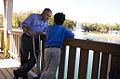 President George W. Bush talks with 10-year-old Hank Grissom at the Victory Junction Gang Camp in Randleman, N.C.jpg
