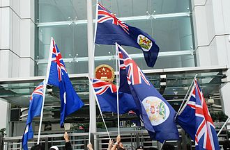 Hong Kong independence - Protesters waving the Hong Kong colonial flags in front of the Chinese Liaison Office in Hong Kong.
