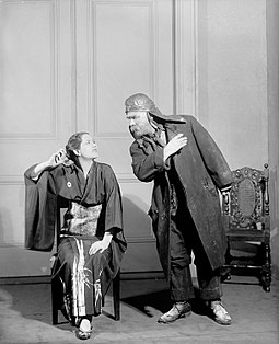 Lynn Fontanne (Eliza) and Henry Travers (Alfred Doolittle) in the Theatre Guild production of Pygmalion (1926) Pygmalion-Fontanne-Travers-1926.jpg