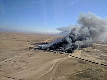 Oil fires burn near Qayyarah, Iraq