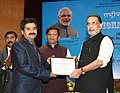 "Radha Mohan Singh presenting the merit certificate to the Frozen Semen Bull Station Salboni, PBGSBS, West Bengal, at the launch of the ""e-pashu haat portal"", in New Delhi.jpg"