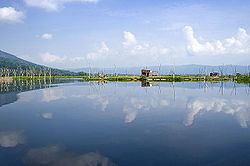 Rawa Pening reflects the clouds in its still water