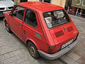 Red Fiat 126 elx Maluch Town on Sienna street in Kraków (2).jpg