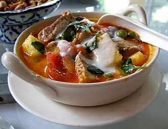Fusion cuisine - Kaeng phet pet yang (Thai roast duck curry) is an example of early fusion cuisine of the cosmopolitan court of the Ayutthaya Kingdom combining Thai red curry, Chinese roast duck and grapes originally from Persia