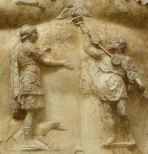 Aquila (Roman) - Detail of the central breastplate relief on the statue of Augustus of Prima Porta shows the return of the Aquilae lost to the Parthians. The return of the eagles was one of Augustus's notable diplomatic achievements.
