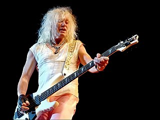 Rick Savage British musician and bass guitarist